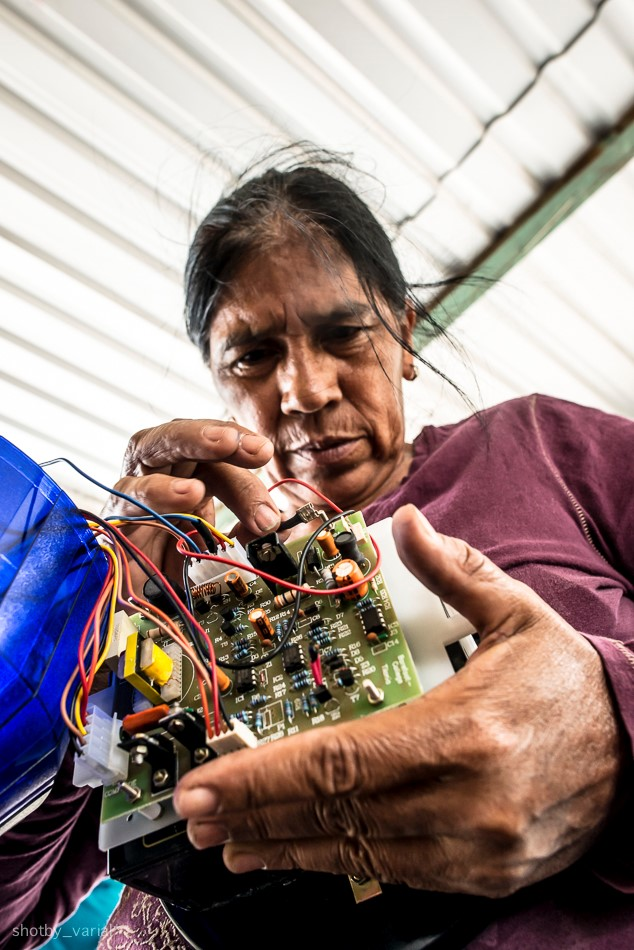 Norma Guerra Works on Circuit Bored for Solar Lantern Barefoot College